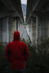 Man at a highway bridge in abandoned environment - RAEF02357