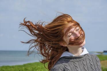Windswept hair of a teenage girl at the coast, Skane, Sweden - LBF02887