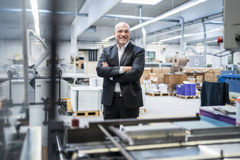 Portrait of a confident businessman in a factory - DIGF09318