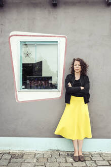 Portrait of brunette woman next to a window of a retro bistro - HBIF00067