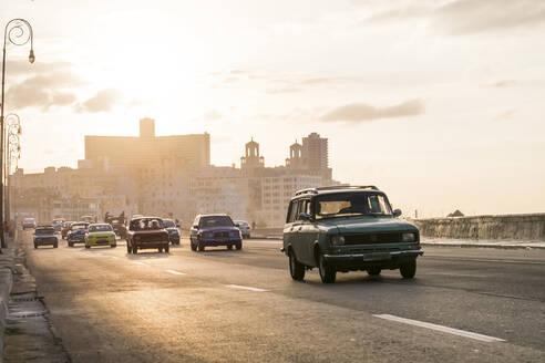 Vintage cars on the street at Malecon, Havana, Cuba - PAF01916