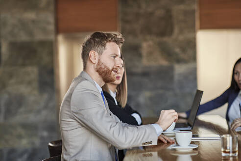 Business people having a meeting in hotel lobby - ZEDF03044