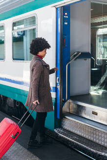 Tourist woman going for vacation trip on train - CAVF75680
