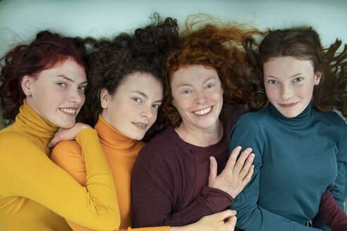 Portrait of happy mother and her three daughters - PSTF00664
