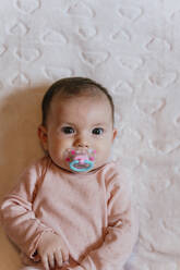 Portrait of baby girl sucking a pacifier - GEMF03462