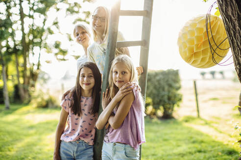 Portrait of girls on a birthday party outdoors - SODF00651