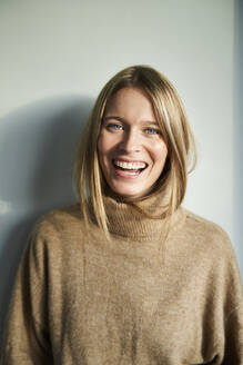 Portrait of laughing blond young woman - PNEF02437