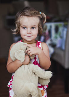 Portrait of little girl with cuddly toy - LJF01379