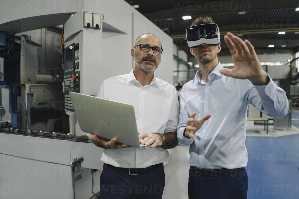 Two men with VR glasses in factory - KNSF07871 - Kniel Synnatzschke/Westend61