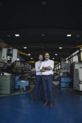 Portrait of two confident men in a factory - KNSF07883