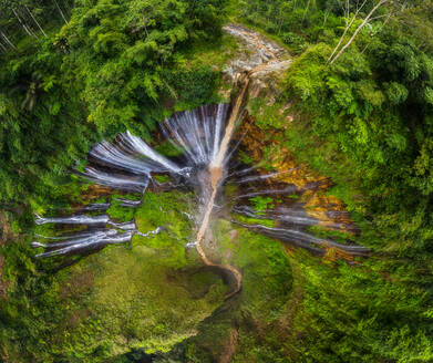Aerial view of Tumpak Sewu Waterfall surrounded by jungle, Indonesia - AAEF06922