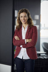 Portait of smiling businesswoman in office - RBF07072