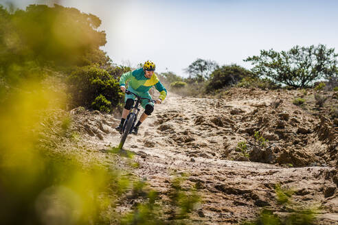 Man riding mountainbike on dirt track, Fort Ord National Monument Park, Monterey, California, USA - MSUF00202