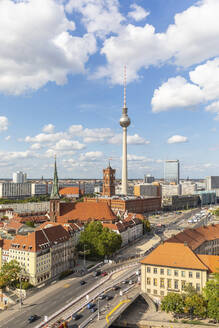 Germany, Berlin, Clouds over Fernsehturm Berlin tower and surrounding buildings - WPEF02705