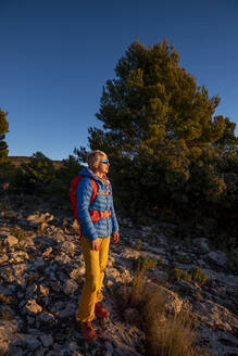 A woman hiking in the high country, El Divino mountain, Costa Blanca - CAVF77031