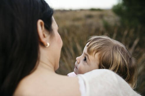 Daughter looking at mother in the countryside - JRFF04150