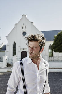 Portrait of man in old-fashioned clothes at a church in the countryside - RORF02033