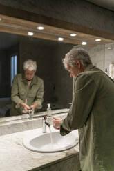 Man washing hands in bathroom - AFVF05764