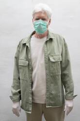 Senior man wearing face mask and protective mask - AFVF05767