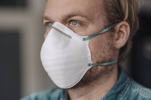 Portrait of man wearing protective mask - JOSEF00102