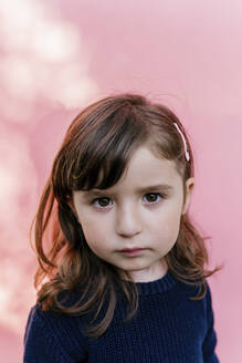 Portrait of sad little girl in front of pink background - GEMF03492