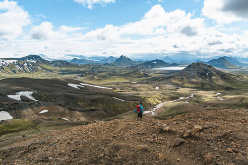 Backpacker Immersed in Alftavatn Valley - CAVF77315