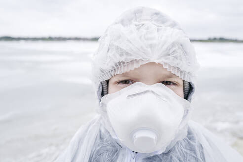 Portrait of boy wearing protective suit and mask - EYAF00984