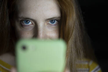Close-up of young woman with cell phone - AFVF05794