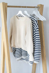 Pullovers hanging on clothes rack - AFVF05811