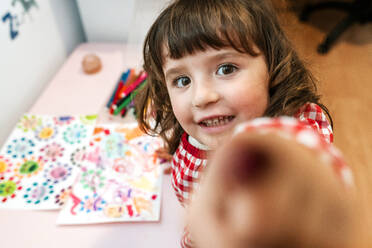 Little girl drawing  ugly viruses with color markers at home - GEMF03506