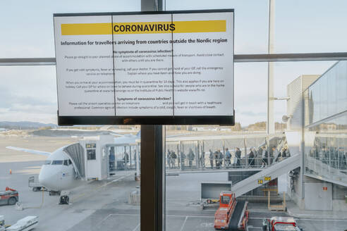 Information sign with safety regulations regarding coronavirus at Oslo airport, Norway - STDF00205