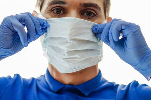 Doctor with face mask, using smartphone - CJMF00278