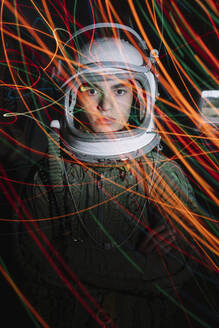 Young spaceman, lost In the dark with color lights - JCMF00467
