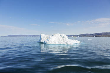 Melting polar ice on sunny blue Atlantic Ocean Greenland - HOXF05796