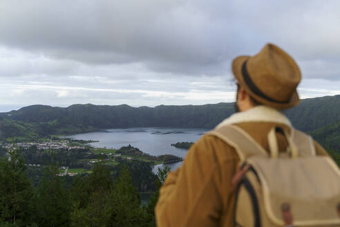 Rear view of man looking at scenic landscape, Sao Miguel Island, Azores, Portugal - AFVF05836