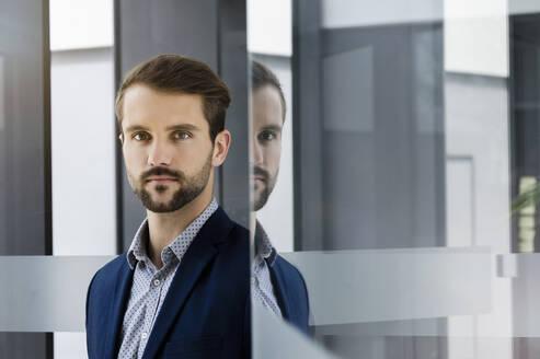 Portrait of self-confident young businessman - BMOF00344