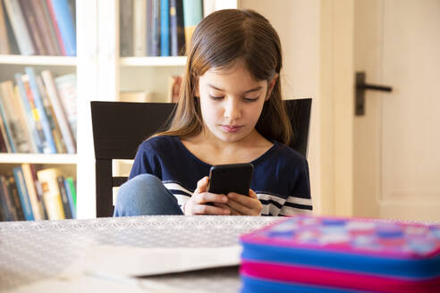 Girl doing homework with smartphone - LVF08703