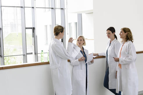 Female doctors having a work meeting in hospital - BMOF00348