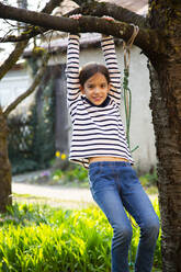 Portrait of smiling girl playing in garden - LVF08726