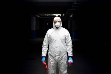 Cleaning staff in suit with sanitizer and cleaning cloth - CJMF00284