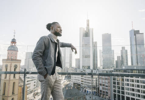Stylish man on observation terrace looking at skycraper view, Frankfurt, Germany - AHSF02144