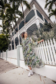 Woman in front of a building in Key West, Florida, USA - DAWF01295