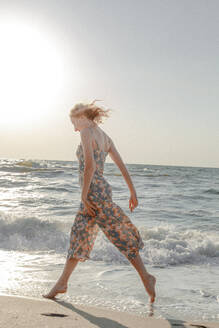 Woman Wading In Sea Against Clear Sky - EYF02708