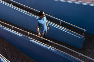 Mature man standing on a ramp looking at distance - ERRF03265