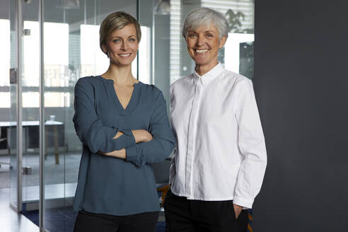 Portrait of two confident businesswomen in office - RBF07352