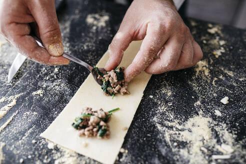 Close-up of man preparing homemade gluten free pasta - JRFF04307