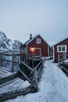 Fishing hut at the coast at dusk, Lofoten, Norway - MPPF00727