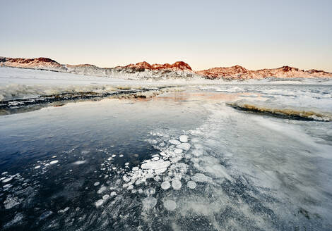 Coastline with ice and snow against rocks in winter - CAVF78343