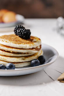 Close up of a stack of fresh homemade pancakes - CAVF78553