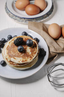 Stack of pancakes with berries, still life overhead shot. - CAVF78556